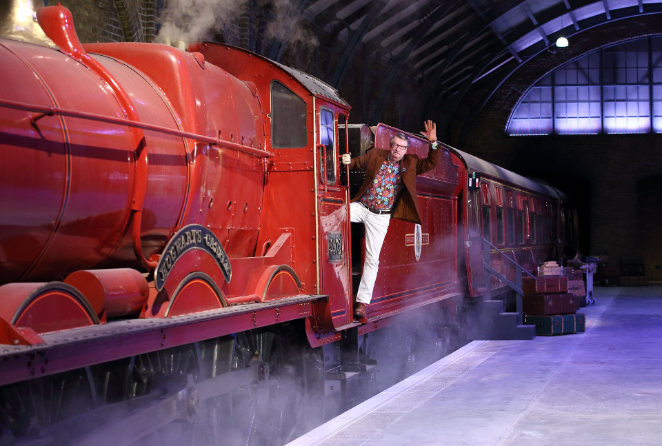 Mark Williams, Mr Weasley, climbs aboard the Hogwarts Express on Platform 9 ¾ at Warner Bros. Studio Tour London – The Making of Harry Potter  ( (3)