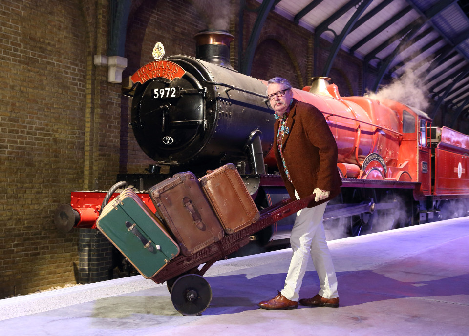 Mark Williams, Mr Weasley in the Harry Potter film series, pushes the luggage trolley on Platform 9 ¾ at Warner Bros. Studio Tour London  (1)