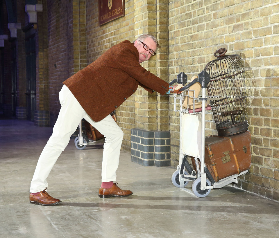 Mark Williams, Mr Weasley in the Harry Potter film series, pushes the luggage trolley on Platform 9 ¾ at Warner Bros. Studio Tour London  (7)