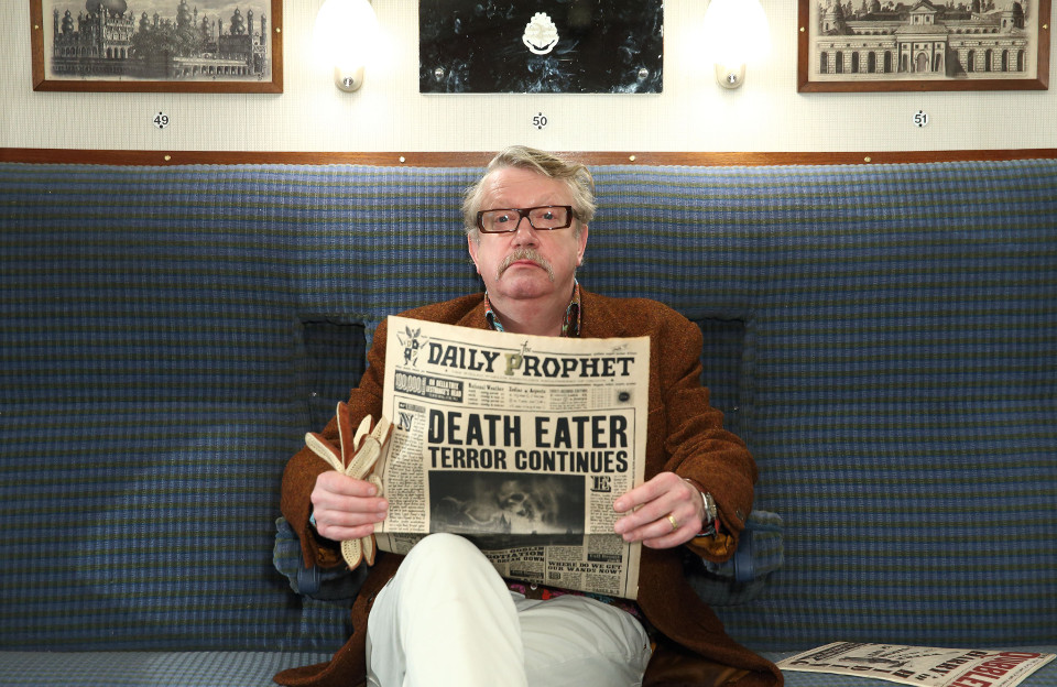 Mark Williams, enjoys a morning read of The Daily Prophet whilst sitting in the Hogwarts Express train carriage at Warner Bros. Studio Tour Lond (3)
