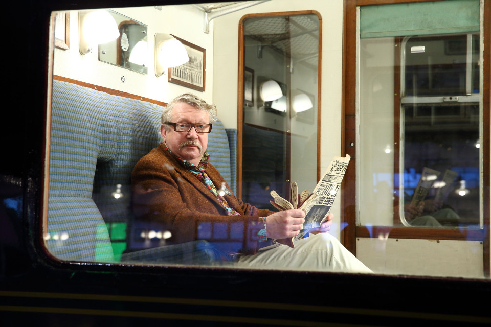 Mark Williams, enjoys a morning read of The Daily Prophet whilst sitting in the Hogwarts Express train carriage at Warner Bros. Studio Tour Lond (4)