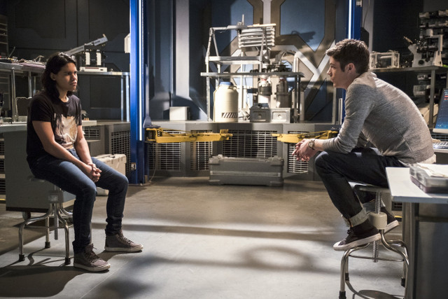 Carlos Valdes as Cisco Ramon and Grant Gustin as Barry Allen.