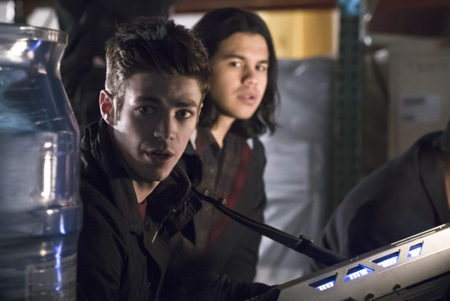 Grant Gustin as Barry Allen/The Flash and Carlos Valdes as Cisco Ramon.