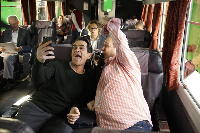 "(L-R): Phil (Ty Burrell) and Cameron (Eric Stonestreet) in ""Crazy Train."""