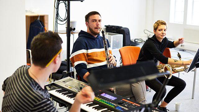 Daniel Large, Mikey Sluman and Lara Jones in rehearsal. Credit: David Lindsay.