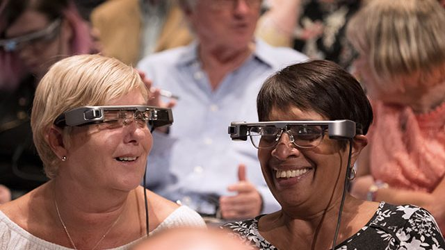 Smart caption glasses like these will be trailed from April. Credit James Bellorini