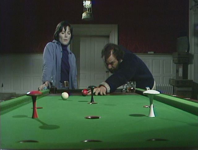 Bar billiards at the Tollbar with Jenny (Lucy Fleming) and Charles (Denis Lill) in The Enemy. Credit: BBC Worldwide.