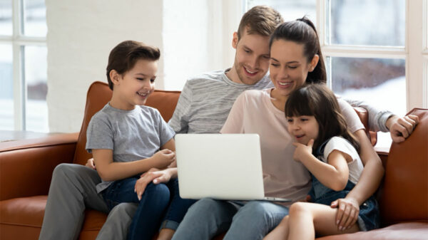 Family watching a laptop